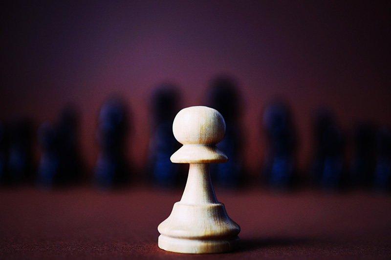 This image has depth because the chess piece in front feels close, but the blurred pieces behind it feel far away.